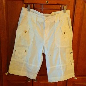 White Bermuda length cargo shorts.